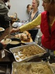 Ann Richardson's team serves an early turkey dinner last Saturday at Laguna's homeless shelter, where volunteers have provided nightly meals for three years.