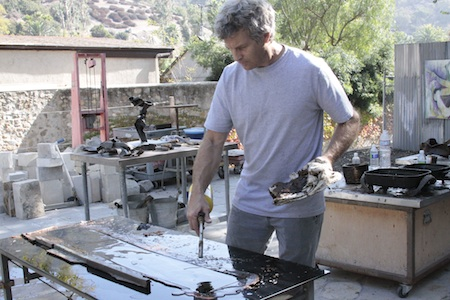 Louis Longi at work in his outdoor studio and site of the approved project.