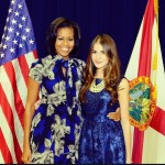 Conn with First Lady Michelle Obama at that campaign rally in October.