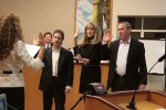 New City Clerk Lisette Chel swears in newly elected council members Steve Dicterow, left, and Bob Whalen and incumbent Treasurer Laura Parisi.