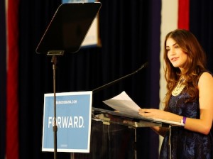 Lisa Conn delivers the field pitch at a 10,000-person campaign rally with Michelle Obama at Broward College in October 2012.