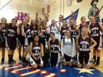 Laguna Beach girls' basketball team celebrates their first ever tournament win.