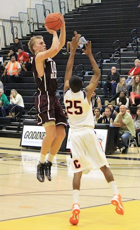 Senior Cole Kessler goes up for a shot against Cypress in the Godinez Invitational Tournament.