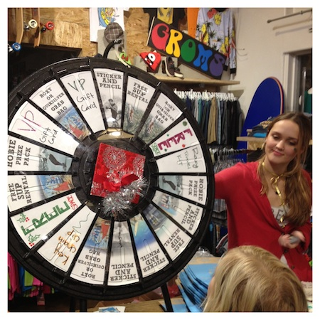 Customers took a spin at the Wheel O Prizes during a Hospitality Night benefit for the Boys and Girls Club at the Hobie Surf Shop.