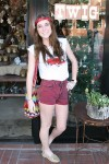 Model Annie Sasso models Twig's vintage shorts and retro t-shirt, part of the shop's fashion show his Sunday.
