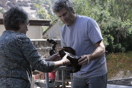An Open Studios visitor assists sculptor Louis Longi.