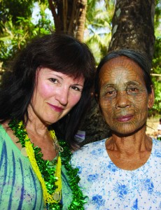 Local Karen Redding with a woman native of Myanmar, whose face bears evidence of a little-known cultural practice. Her photos explore cultural norms around the globe.