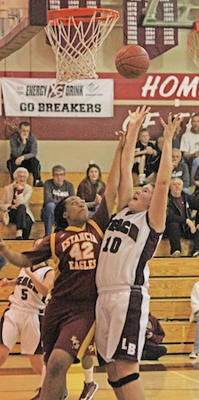 Junior Jane Wallin Works for two of her team high 14 against Estancia at Dugger Gym on Thursday, Jan. 24.
