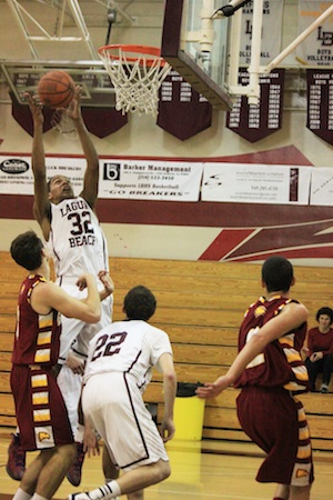 Junior Noah Blanton goes up for a rebound against Estancia at Dugger Gym.