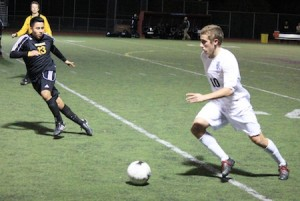 Junior Reece Barton in action against Godinez in Laguna's 3-1 home loss Jan. 18.