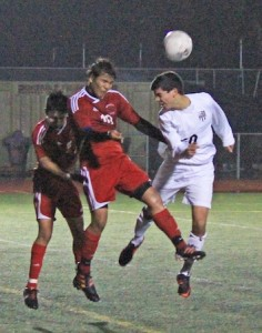 Sophomore Zach Jacobs heads the ball against Estancia in Laguna's 3-3 tie at home last Friday.