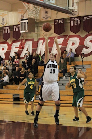 Photo by Robert CampbellJunior center Jane Wallin goes up for an easy bucket against Saddleback in Laguna's league opener. Laguna won the game 69-12 and are now 13-1 on the season.