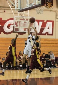 Freshman Jackie Cenan scores two of her 10 points against Estancia at Dugger Gym on Thursday, Jan. 24.