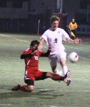 Sophomore Jake Hexberg gets tripped up by an Estancia player in Laguna's 3-3 tie at home last Friday.