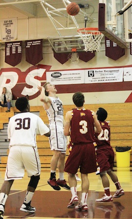 Senior Cole Kesler floats in two of his game-high 21 points against Estancia last Friday at Dugger Gym.