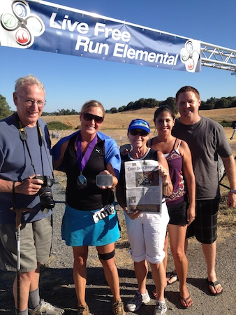 Local Jenn Prewitt, second from left, at the finish line after completing the Cool Moon 100-Mile EnduranceRun in August with her family, Paul, Cindy, Thanya and Sean.
