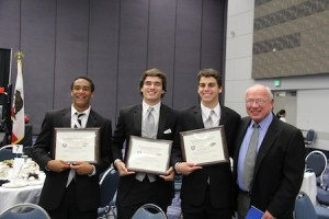 From left, players Robert Clemons, Spencer Anderson and Adam Farsheed with LBHS coach Mike Churchill.