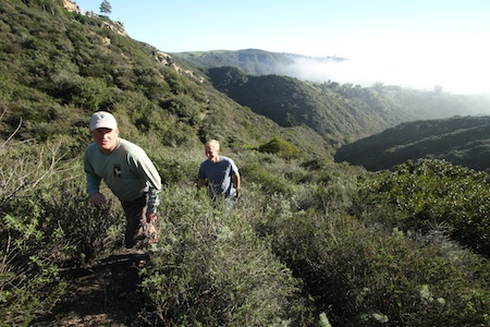 Laguna Canyon Foundation leaders Max Borella and Derek Ostensen take to the trails on newly acquired open space in Rim Rock Canyon.