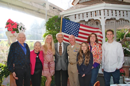 Photo by Matt Cole     Patriots Day Parade honorees, from left, Arnold and Bonnie Hano, Michelle Brown, Joseph A. Pursch, Grand Marshal Capt. Jason Ehret, an unidentified girl, Dee Challis Davy and Brock Csira