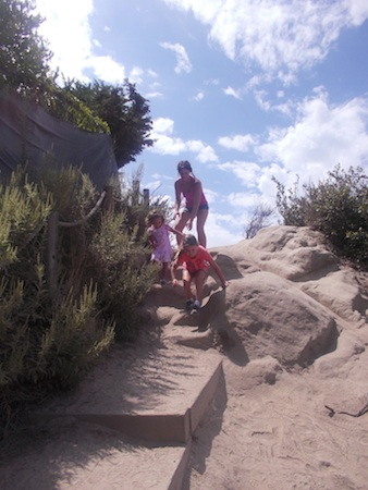 Lori Mitsuka and her daughters, Alice and Sanae, last August on the unimproved public path in the old Top of the World neighborhood.
