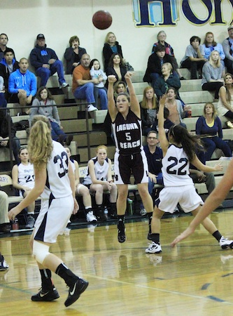 Senior Kylie Even puts up a jumper against Calvary Chapel.