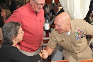 Patriots' Day Parade grand marshal Capt. Jason Ehret greets well-wishers during a brunch on Sunday.