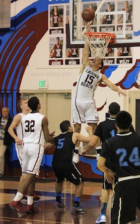 Senior Jake Dalke goes up for a block against a Salesian.