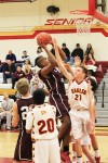 Junior Noah Blanton goes up for two of his career high 22 points against Estancia earlier this season. Credit: Robert Campbell