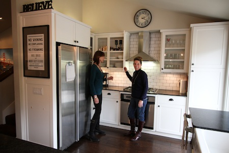 Dorit Lessard, left, who hopes to take advantage of escalating home prices, describes her home's features to to agent Pamela Horton.