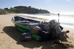 A panga style boat abandoned at Crystal Cove in 2010 in a suspected human smuggling incident.