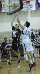 Junior Bryan Ludloff lays one in the over a Calvary Chapel defender.