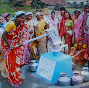 Villagers in India using their new water source, which was funded by local organizations.