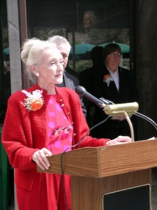 Nancy Lawrence in a 2006 speech at LCAD. A vintage photo from a '60s Color it Orange exhibition.