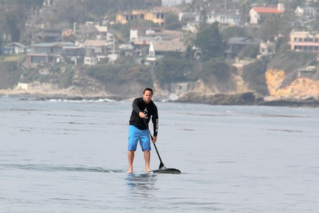 SUP Co. employee Eric Gittil skips out for a quick paddle during this week's glassy conditions. Photo by Edgar Obrand