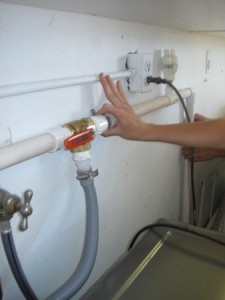 A bypass valve at a washing machine can divert rinse water to the garden.