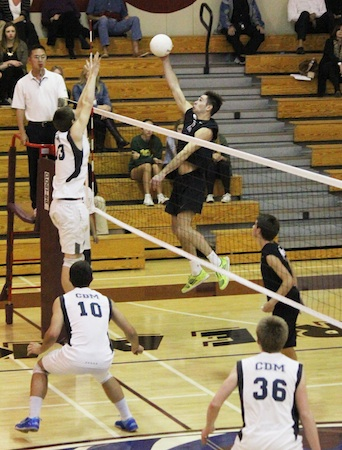 Junior Maxx McCarter goes up for the kill in Laguna's 3-0 win over Corona del Mar.