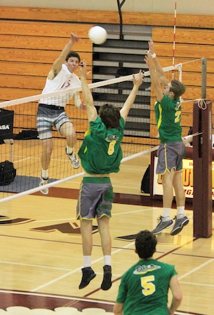 Senior outside hitter Weston Barnes knocks down the kill in Laguna's season and home opener at Dugger Gym against Edison of Huntington Beach. The Breakers won 3-1.