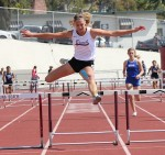 Freshman Coco Putnam clears the final hurdle in the frosh/soph 300m hurdles.