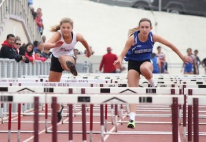 Junior Darby Winson (left) in the varsity 100m hurdles.