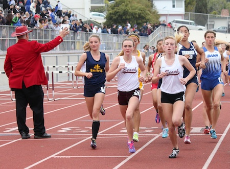 Freshman Pearl Shoemaker and sophomore Olivia Clark lead the first lap of the Eric Hulst 3200m.