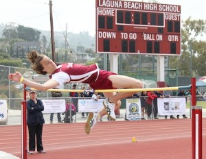 Junior Kailar Pike clears the bar in the varsity high jump.
