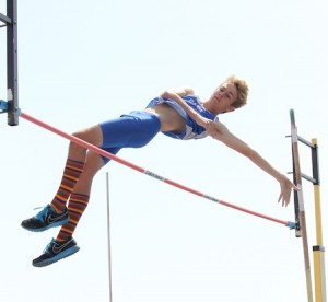 A Dana Hills vaulter clears the bar in the pole vault.
