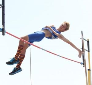 A Dana Hills vaulter clears the bar in the pole vault.