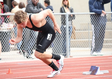 Senior Reece Barton fires out of the blocks at the start of the 400m.