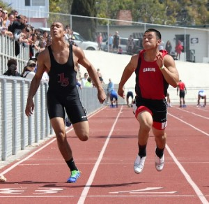 Senior Robert Clemons stretches for the finish in the 100m dash.