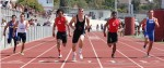 Senior Drake Martinez (center) wins the final heat of the 100m dash.