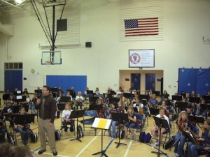 Rich Hartford directs the combined TOW and El Morro string programs in concert at Thurston Middle School.