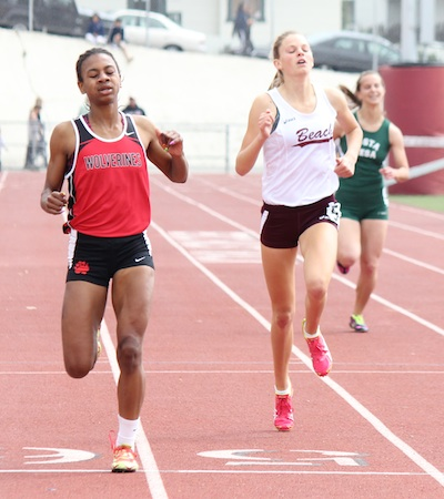 Sophomore Janie Crawford kicks to the finish of the varsity 400m.