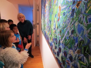 Club members examine Allison Schulnik's artwork.