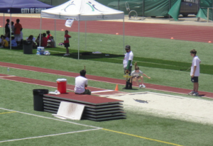 A young long-jumper hopping into the pit during last year's event.
